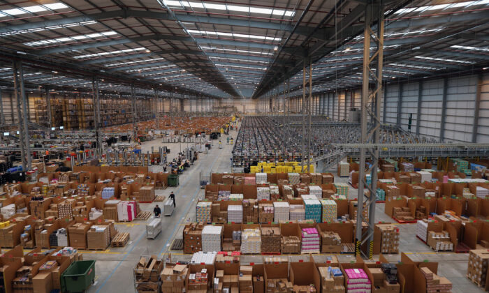 Employees select and dispatch items in the huge Amazon 'fulfillment center' warehouse in Peterborough, England, on Nov. 28, 2013. (Oli Scarff/Getty Images)