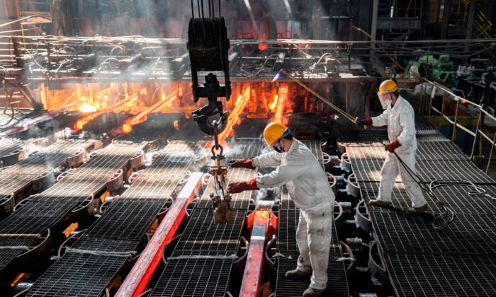 Workers make iron bars in a steel factory in Lianyungang, in China's eastern Jiangsu Province, on Feb. 12, 2021. (AFP via Getty Images)