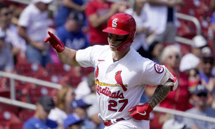 St. Louis Cardinals' Tyler O'Neill celebrates as he rounds the bases after hitting a solo home run during the fifth inning of a baseball game against the Los Angeles Dodgers in St. Louis on Sept. 9, 2021. (AP Photo/Jeff Roberson)