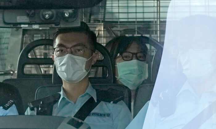 Chow Han Tung, vice chairwoman of the Hong Kong Alliance in Support of Patriotic Democratic Movements of China (C) is escorted by police in a van to a court, in Hong Kong, on Sept. 10, 2021. (Kin Cheung/AP Photo)