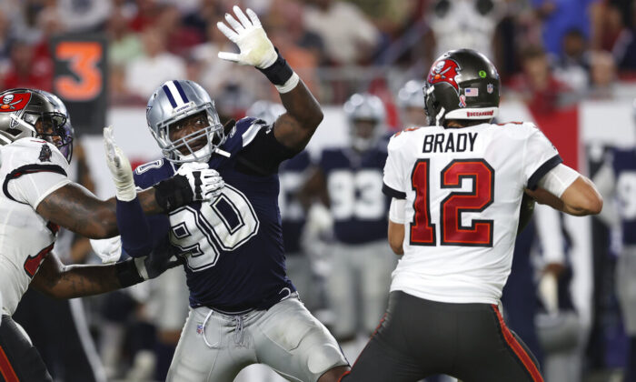 Dallas Cowboys defensive end DeMarcus Lawrence (90) pressures Tampa Bay Buccaneers quarterback Tom Brady (12) during the second half of an NFL football game in Tampa, Fla., on Sept. 9, 2021. (Mark LoMoglio/AP Photo)