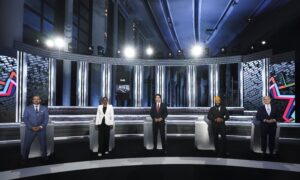 Leaders Trade Barbs on 'Two Michaels,' China Human Rights in English Debate