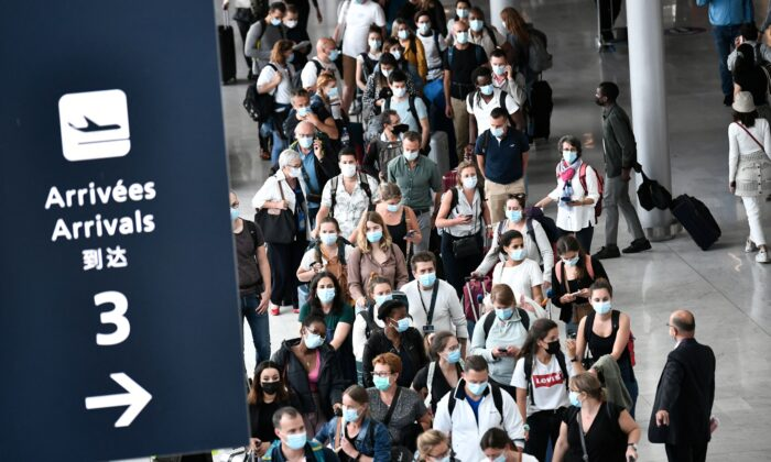 Travelers arrive at the Orly airport in Orly, near Paris, on Aug. 20, 2021. (Stephane de Sakutin/AFP via Getty Images)