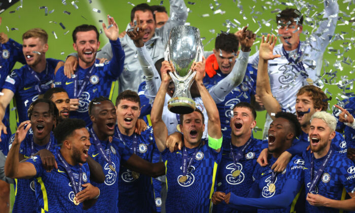 Cesar Azpilicueta of Chelsea lifts the UEFA Super Cup Trophy following victory in the UEFA Super Cup 2021 match between Chelsea FC and Villarreal CF at the National Football Stadium at Windsor Park in Belfast, Northern Ireland, on Aug. 11, 2021. (Catherine Ivill/Getty Images)