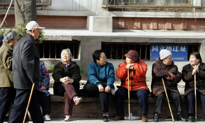 A group of elderly people enjoys a day in Beijing, China on 7 April 2007. China will expand its social security fund to at least $200 billion within a decade in a bid to meet the surging demand for pensions from its aging population, as the country currently has 144 million people who have already passed their 60th birthday, accounting for half of Asia's entire population in that age group, while another 100 million will be added roughly every 15 years and after 2030 the population that will be in the labour force to support those who are either too young or too old to work will shrink to less than half. (AFP/AFP via Getty Images)