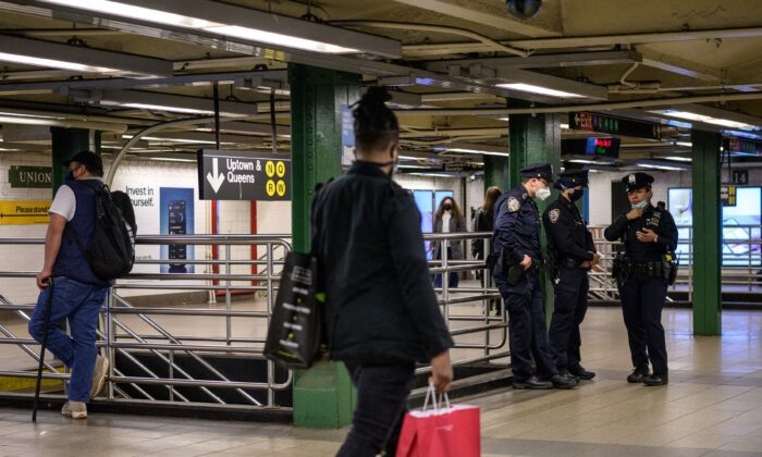 New York Police Officers stand at the Union Station subway stop in New York on May 10, 2021. (Angela Weiss/AFP via Getty Images)