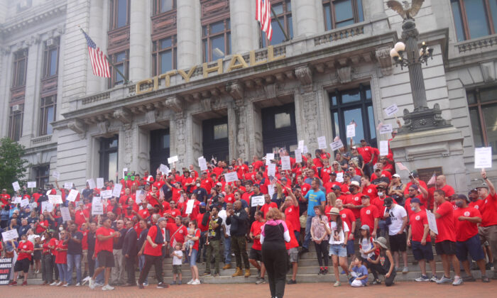 People participate in the rally outside the City Hall organized by firefighters and police unions to demand negotiations on the COVID-19 Vaccine Mandate in Newark, N.J., on Sept. 8, 2021. (Ella Kietlinska/The Epoch Times)