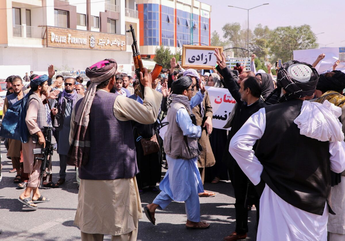 Taliban forces try to stop the protesters, as they shout slogans during an anti-Pakistan protest, near the Pakistan embassy in Kabul, Afghanistan
