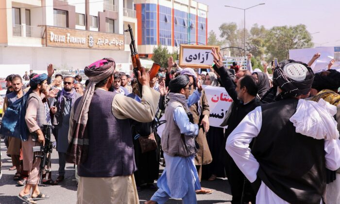 Taliban fighters try to stop the protesters, as they shout slogans during an anti-Pakistan protest, near the Pakistan embassy in Kabul, Afghanistan, on Sept. 7, 2021. (Stringer/Reuters)