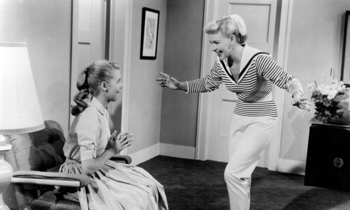 """Nancy Fallon (Ginger Rogers, R) tries to win back the love of her troubled 15-year-old Dodie McGowan (Betty Lou Keim), in """"Teenage Rebel."""" (Public Domain)"""