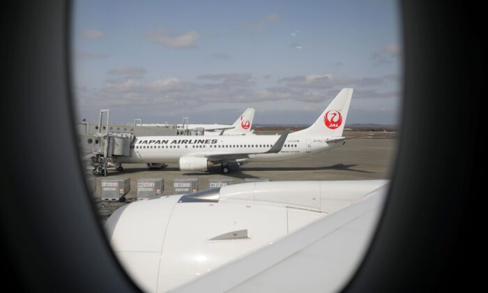 Japan Airlines (JAL) planes sit on the tarmac at New Chitose Airport, in Sapporo, Hokkaido, Japan on May 4, 2021. (Issei Kato/Reuters)