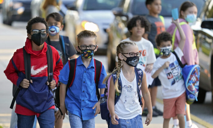 Students, some wearing protective masks, arrive for the first day of school at Sessums Elementary School in Riverview, Fla., on Aug. 10, 2021. (Chris O'Meara/AP Photo)