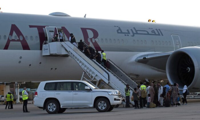 Passengers board a Qatar Airways aircraft at the airport in Kabul, Afghanistan, on Sept. 9, 2021. (Wakil Kohsar/AFP via Getty Images)