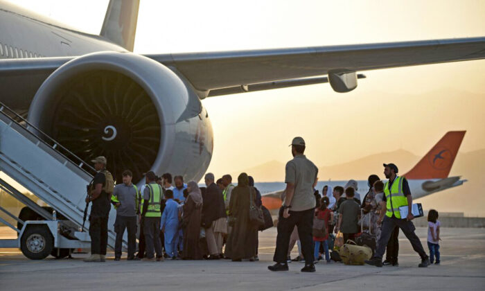 Passengers prepare to board a Qatar Airways aircraft at the airport in Kabul, Afghanistan, on Sept. 9, 2021. (Wakil Kohsar/AFP via Getty Images)