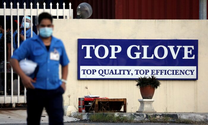A worker leaves a Top Glove factory after his shift in Klang, Malaysia on Dec. 7, 2020. (Lim Huey Teng/Reuters)