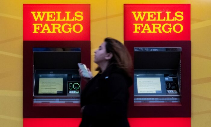 A woman walks past Wells Fargo bank in New York City on March 17, 2020. (Jeenah Moon/Reuters)