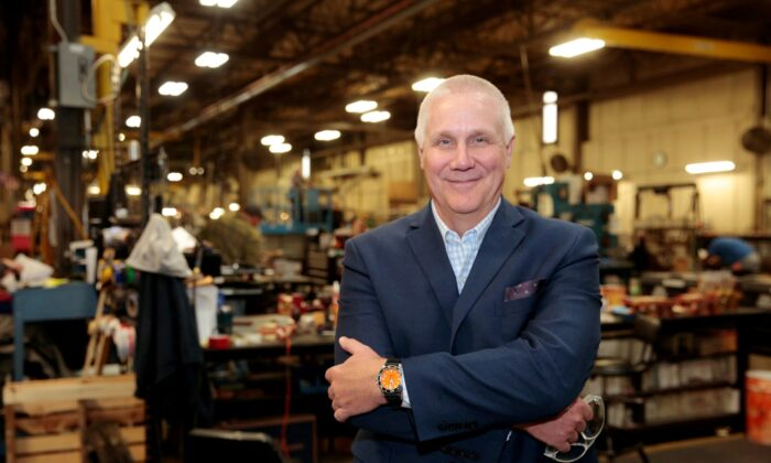 Bob Roth, CEO of transformer manufacturer RoMan Manufacturing, poses for a photograph in his plant in Grand Rapids, Mich., on Dec. 12, 2018. (Rebecca Cook/Reuters)