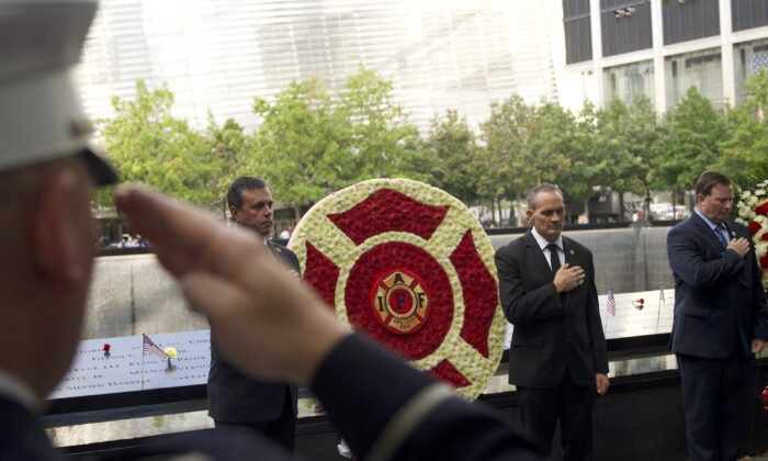 The International Association of Firefighters conducts a wreath laying ceremony for the 20th anniversary of the 9/11 terrorist attacks at the World Trade Center memorial site in Manhattan, New York, on Sep. 10, 2021. (Enrico Trigoso/The Epoch Times)