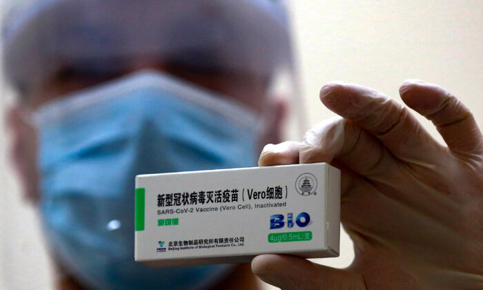 A health worker shows a dose of the Chinese Sinopharm vaccine for COVID-19 disease, at a vaccination centre in the Jordanian capital Amman, on January 13, 2021.  (KHALIL MAZRAAWI/AFP via Getty Images)