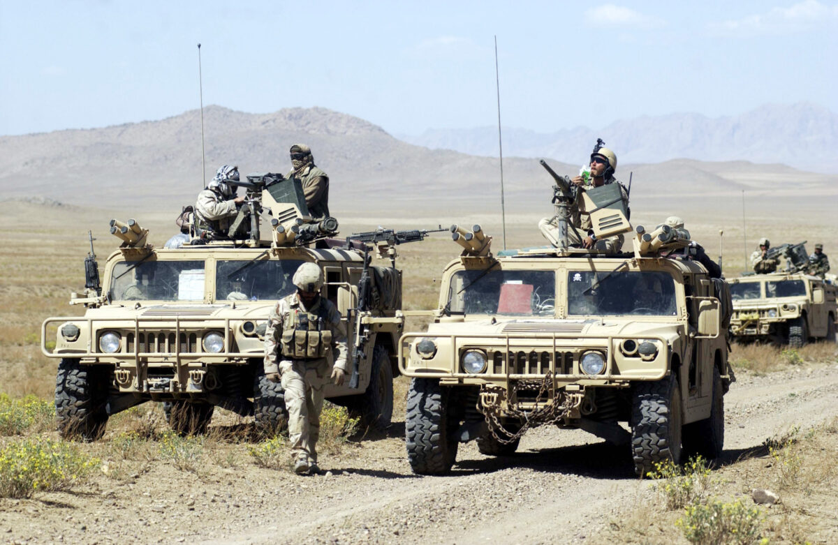 U.S. Special Forces soldiers with Task Force 31 stop their convoy on the way to conduct joint village searches with the Afghan National Army March 29, 2004 in southeast Afghanistan. U.S. Special Forces and the Afghan National Army, trained by special forces and U.S. Marines, are together stepping up the hunt for Taliban and al Qaeda forces. The deployment of the ANA to the southeast marks the first time the army has been seen by locals in this region. (Darren McCollester/Getty Images)