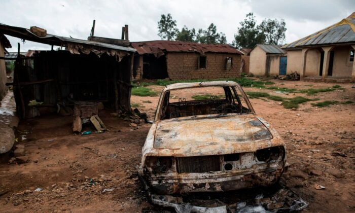 A burnt out vehicle is seen in the Nghar Village, near Jos on June 27, 2018. Fulani herdsmen attacked the village.   STEFAN HEUNIS/AFP via Getty Images)