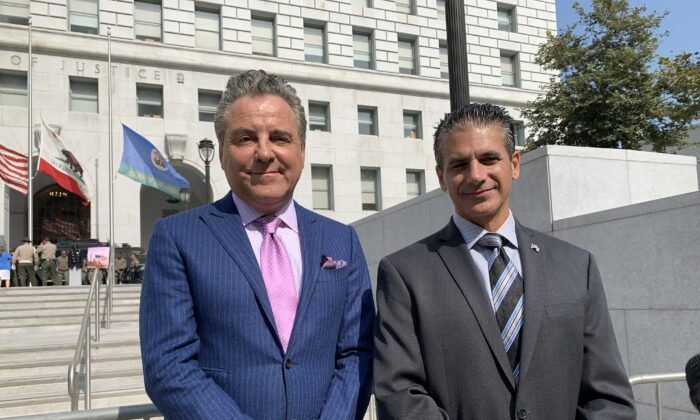 Los Angeles County Deputy District Attorney Jon Hatami (R) and attorney Brian Claypool (L) held a press release in front of the Hall of Justice in downtown Los Angeles  on Sept. 8, 2021. (Linda Jiang/The Epoch Times)
