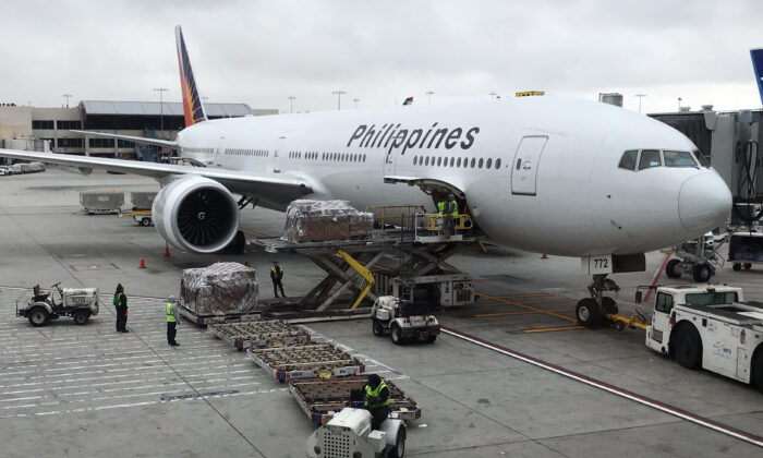 A Philippine Airlines Boeing 767 airplane sits at a gate at Los Angeles International Airport on May 24, 2018. (Daniel Slim/AFP via Getty Images)