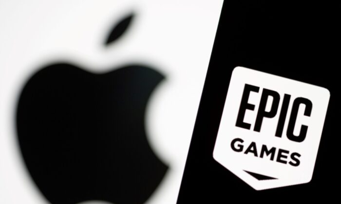 Smartphone with Epic Games logo is seen in front of Apple logo in this illustration taken, on May 2, 2021. (Dado Ruvic/Illustration/Reuters)