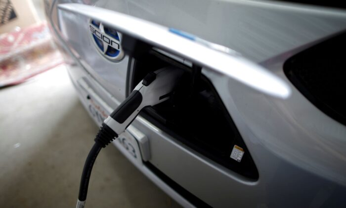 Computer science professor Christa Lopes' Scion IQ electric car is plugged in in her garage in Irvine, Calif., on Jan. 26, 2015. (Lucy Nicholson/Reuters)