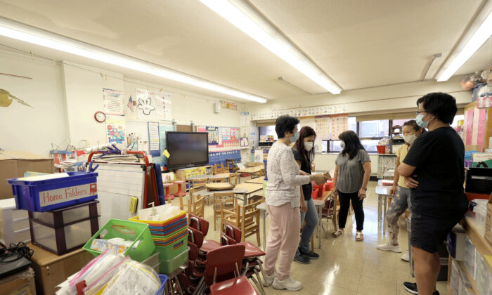 Teachers in Yung Wing School P.S. 124 in New York City, on Sept. 2, 2021. (Michael Loccisano/Getty Images)