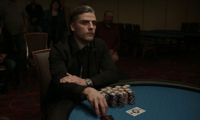 """William Tell (Oscar Isaac), an Iraq War veteran and convicted felon, earns his living playing poker in, """"The Card Counter."""" (Focus Features/Copyright 2021 Focus Features, LLC)"""