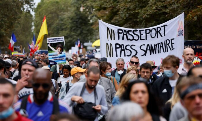 Demonstrators march during a protest against COVID-19 vaccine passports on De Villiers Avenue in Paris on Sept. 11, 2021. The sign reads 'Neither passport nor health pass'. (Thomas Samson/AFP via Getty Images)