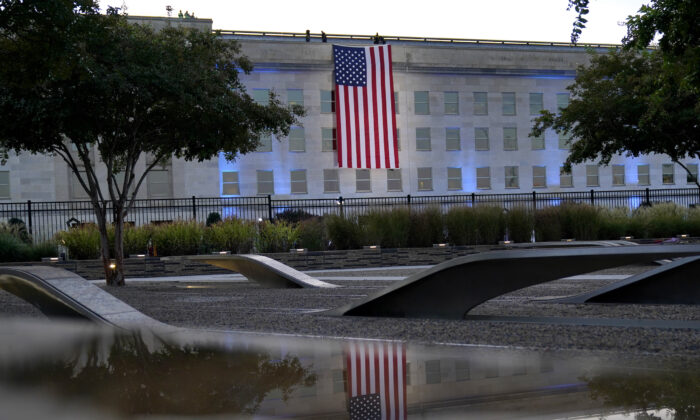 An American flag is unfurled at the Pentagon in Washington at sunrise on the morning of the 20th anniversary of the terrorist attacks on Sept. 11, 2021. (Alex Brandon/AP Photo)