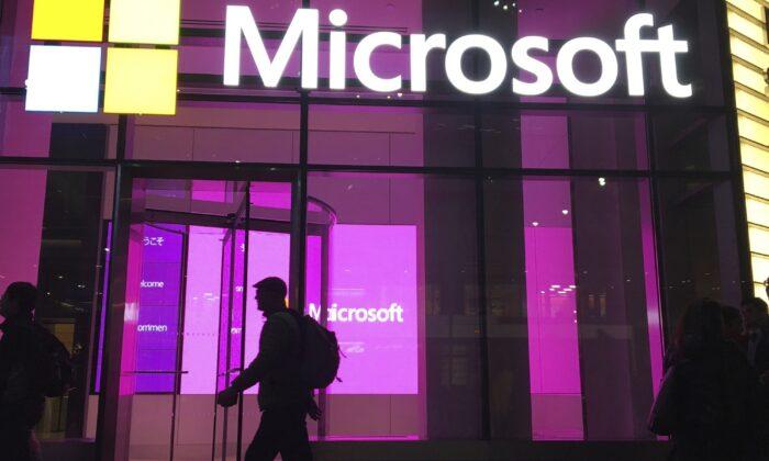 People walk near a Microsoft office in New York on Nov. 10, 2016. (Swayne B. Hall/AP Photo)