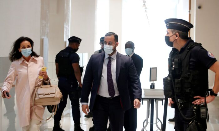 Alexandre Benalla, a former security advisor of French President Emmanuel Macron, arrives with his lawyer Jacqueline Laffont on the first day of his trial for violence committed against demonstrators at a May Day protest in 2018, at the courthouse in Paris, France, on Sept. 13, 2021. (Benoit Tessier/Reuters)