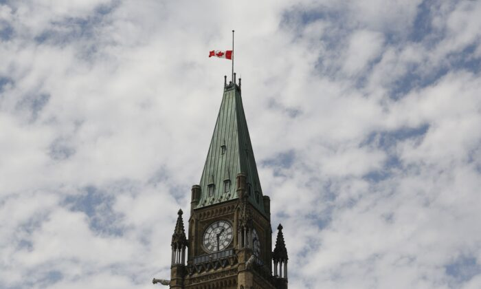 The Canadian flag on the Peace Tower on Parliament Hill flies at half-mast in recognition of the discovery of unmarked graves at residential schools, on Canada Day, July 1, 2021. (The Canadian Press/Patrick Doyle)