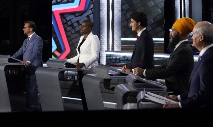 (L–R) Bloc Quebecois Leader Yves-Francois Blanchet, Green Party Leader Annamie Paul, Liberal Leader Justin Trudeau, NDP Leader Jagmeet Singh, and Conservative Leader Erin O'Toole take part in the English-language leaders' debate in Gatineau, Que., on Sept. 9, 2021. (The Canadian Press/Adrian Wyld)