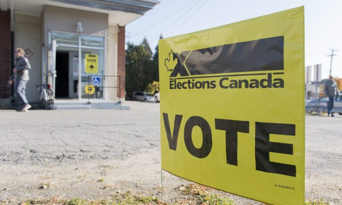 A sign outside a polling station on federal election day in Shawinigan, Que., on, Oct. 21, 2019. (The Canadian Press/Graham Hughes)