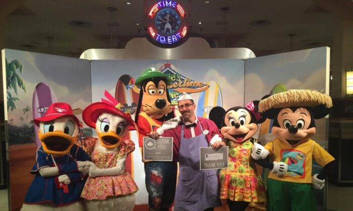 Nick Caturano, a 16-year employee at Disney World in Orlando, Fa, poses with a number of Disney characters at a recent event. (Courtesy of Nick Caturano)