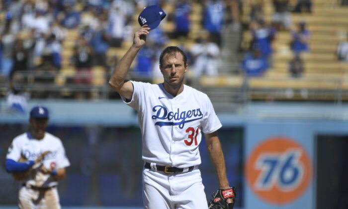 Los Angeles Dodgers Max Scherzer tips his cap after he pitched his 3000th career strikeout against San Diego Padres first baseman Eric Hosmer in the fifth inning during in a baseball game in Los Angeles on Sept. 12, 2021. (AP Photo/John McCoy)
