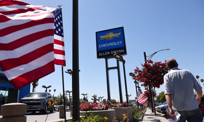 A person walks past a Chevrolet dealership in Glendale, Calif., on Aug. 4, 2021. (Mario Tama/Getty Images)