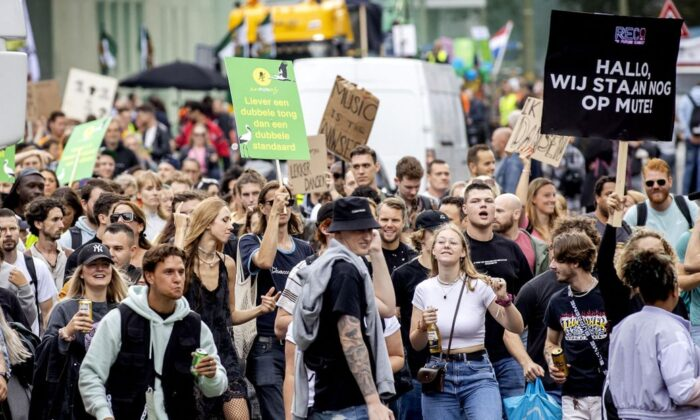 People participate in the Unmute Us! march to protest against COVID-19 policy across the Netherlands In The Hague, on Sept. 11, 2021. (Koen Van Weel/ANP/AFP via Getty Images)