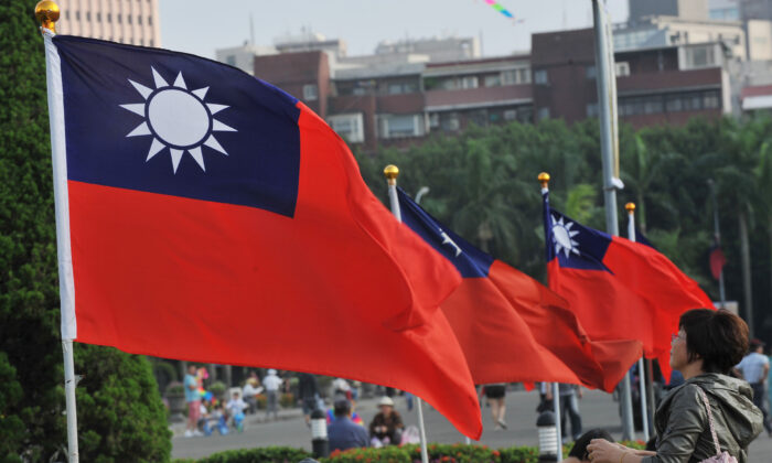 Taiwan's national flags flutter beside Taipei 101 at Sun Yat-sen Memorial Hall in Taipei on Oct. 7, 2012. (Mandy Cheng/AFP via Getty Images)