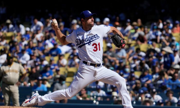 Los Angeles Dodgers starting pitcher Max Scherzer (31) throws a pitch in the seventh inning against the San Diego Padres at Dodger Stadium in Los Angeles, Calif., on Sep 12, 2021. (Robert Hanashiro/USA TODAY Sports via Reuters)