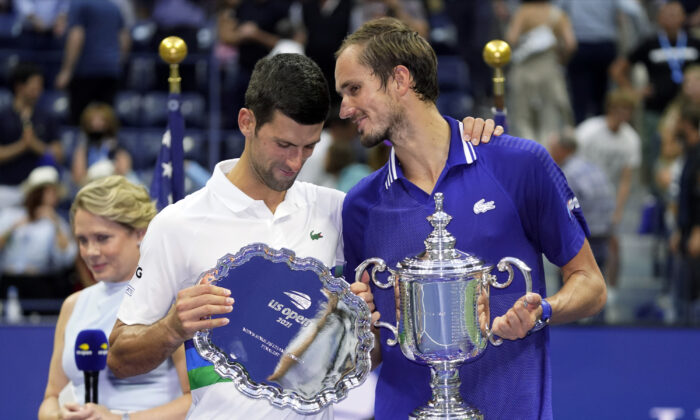 Daniil Medvedev of Russia (R) talks with Novak Djokovic of Serbia after defeating Djokovic in the men's singles final of the U.S. Open tennis championships in New York on Sept. 12, 2021. (John Minchillo/AP Photo)