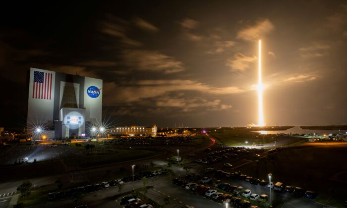 With a view of the iconic Vehicle Assembly Building at left, a SpaceX Falcon 9 rocket soars upward from Launch Complex 39A carrying the company's Crew Dragon Endeavour capsule and four Crew-2 astronauts towards the International Space Station at NASA's Kennedy Space Center in Cape Canaveral, Fla., on April 23, 2021. (Ben Smegelsky/Nasa via Reuters)