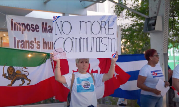 Iranian and Cuban communities rally outside the constituency office of Liberal Leader Justin Trudeau in Montreal on Sept. 11, 2021. (NTD Television)