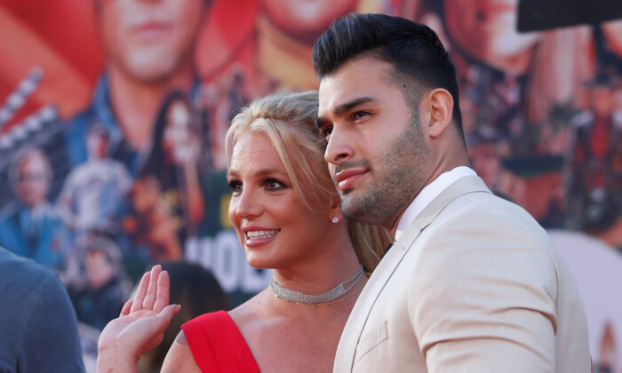 """Britney Spears and Sam Asghari pose at the premiere of """"Once Upon a Time In Hollywood"""" in Los Angeles, Calif., on July 22, 2019. (Mario Anzuoni/Reuters)"""