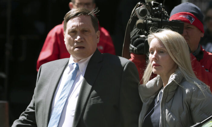 Investor John Wilson (L) and his wife Leslie arrive at a federal court in Boston, Mass., on April 3, 2019. (Charles Krupa/AP Photo)