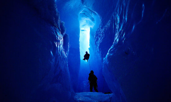 Explorer Snaps Awe-Inspiring Photos Inside the Treacherous Ice Caves of Greenland's Ice Sheet